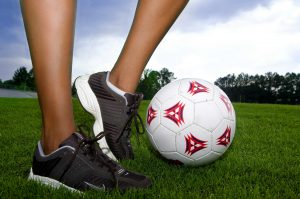 Young woman in game of soccer